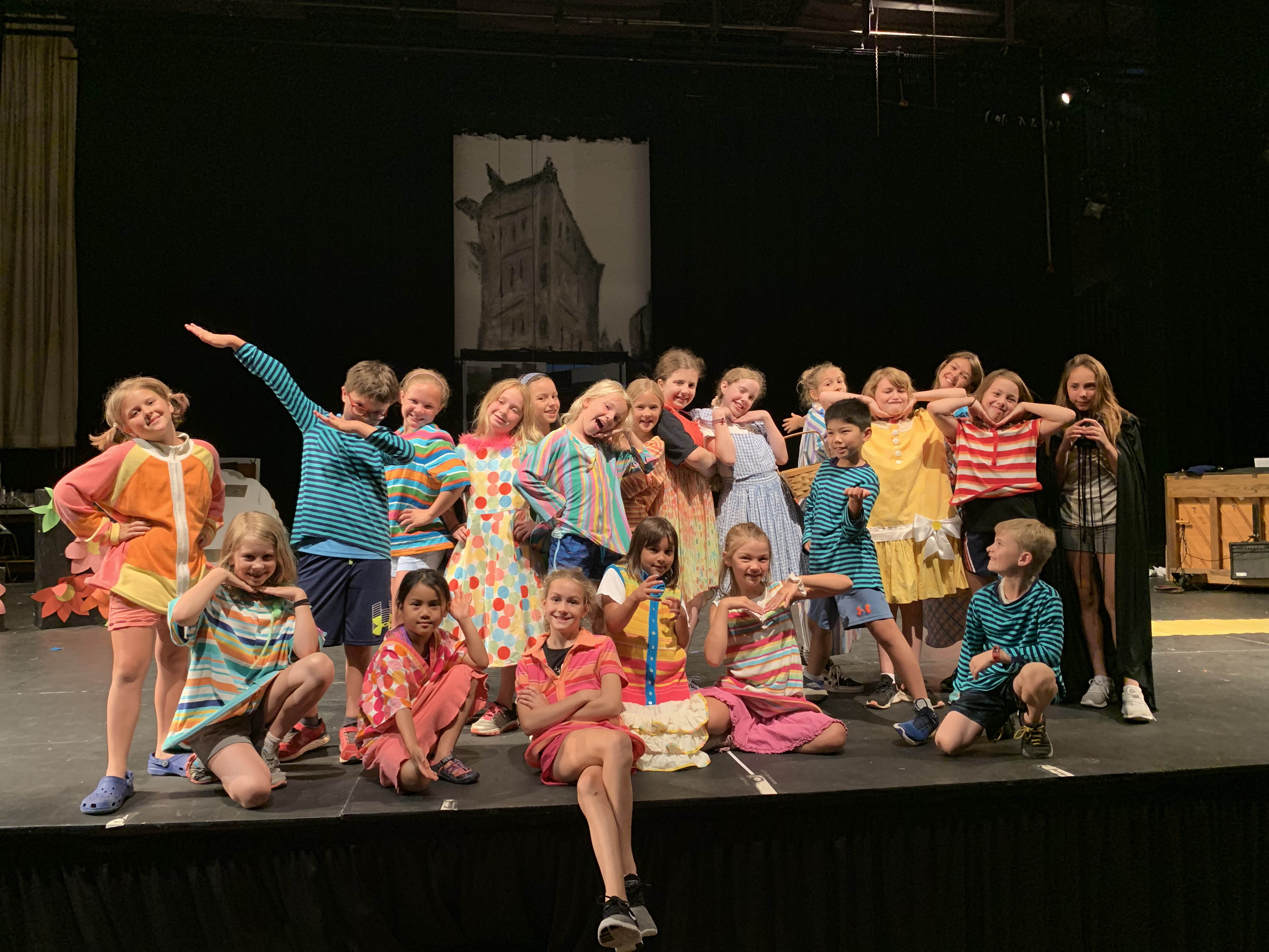 Students in theater camp pose for a photo on the Vis stage